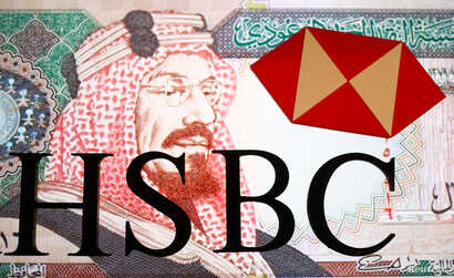 FILE - An HSBC logo is seen in front of a displayed Saudi Arabia Riyal banknote in this illustration, Aug. 8, 2017.