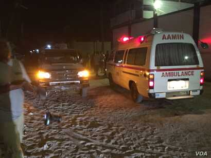 One of the Aamin ambulances waits outside Pizza House as Somali security forces end an al-Shabab siege of two Mogadishu restaurants early Thursday morning. About two dozen people were killed.