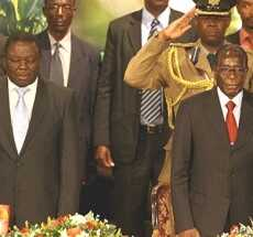 PM Morgan Tsvangirai (L) and President Robert Mugabe (R) are pictured at Zimbabwe International Investment Conference in Harare, 09 Jul 2009