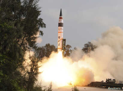 FILE - A surface-to-surface Agni V missile is launched from the Wheeler Island off the eastern Indian state of Odisha April 19, 2012. India test-fired the long range missile capable of reaching deep into China and Europe, thrusting the emerging Asian