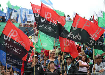 People hold flags during an anti-capitalist meeting at a local stadium, ahead of the Group of 20 gathering, in Buenos Aires, Argentina, Nov. 27, 2018.