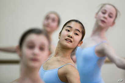 Students perform in a ballet class at the Bolshoi Ballet Academy in Moscow, Russia, March 3, 2016.