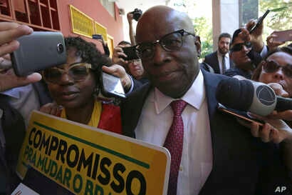 Former Supreme Court President Joaquim Barbosa, the first black member of the country's top court, arrives for a meeting with the leaders of the Brazilian Socialist Party, April 19, 2018.