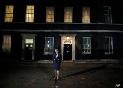FILE - Britain's Prime Minister Theresa May speaks on the draft Brexit deal outside 10 Downing Street in London, Nov. 14, 2018.