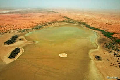 An aerial view of the dried up Lake Banzena in the drought-stricken Gourma region of Mali, May 24, 2009.