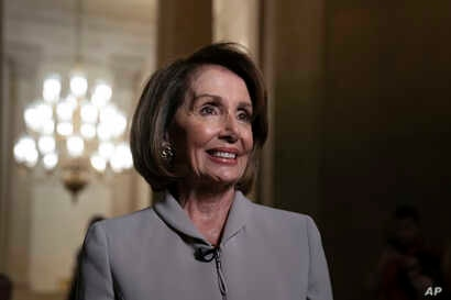 House Democratic Leader Nancy Pelosi of California, who will become speaker of the House Thursday, walks to her new office at the Capitol in Washington, Jan. 2, 2019. The Republicans will relinquish the majority to House Democrats under the leadershi...