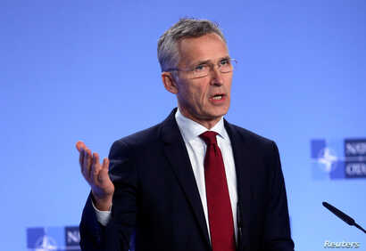 NATO Secretary-General Jens Stoltenberg holds a news conference after a meeting with the ambassadors at the Alliance headquarters in Brussels, Belgium, Nov. 26, 2018.