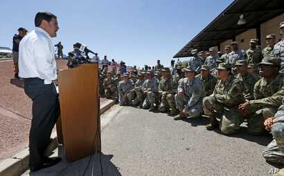 Arizona Republican Gov. Doug Ducey speaks to Arizona National Guard soldiers prior to deployment to the Mexico border at the Papago Park Military Reservation in Phoenix, April 9, 2018.