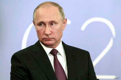 """Russian President Vladimir Putin speaks to the media after the G-20 summit in Buenos Aires, Argentina, Dec. 1, 2018. Putin and Trump """"said hi to each other,"""" according to the Russian leader's spokesman,  but didn't shake hands or otherwise speak."""