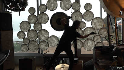 William Close has invented nearly 100 instruments, including a percussive device with dozens of drum heads. (M O'Sullivan/VOA)