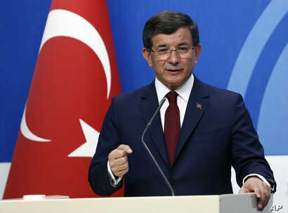 Turkish Prime Minister Ahmet Davutoglu speaks to the media at the headquarters of his ruling Justice and Development Party, AKP, in Ankara, Turkey, May 5, 2016.