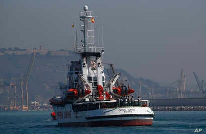 The Open Arms aid boat, of Proactiva Open Arms Spanish NGO, approaches the port of Barcelona, Spain, July 4, 2018.