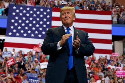 President Donald Trump arrives to speak at a campaign rally at the Landers Center Arena, Oct. 2, 2018, in Southaven, Mississippi.