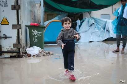 FILE - A child at Vial centre on the Greek Island of Chios. Conditions at the camp have prompted protests in the past.
