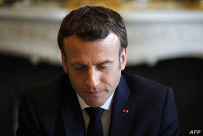 French President Emmanuel Macron meets French representatives of the Ibuka association for the memory of Rwanda's genocide, two days ahead of the 25th anniversary of the 1994 genocide, at the Elysee presidential Palace in Paris on April 5, 2019.