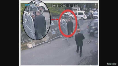A still image taken from CCTV video and obtained by TRT World claims to show Saudi journalist Jamal Khashoggi, highlighted in a red circle by the source, as he stands with his fiancee Hatice Cengiz outside the Saudi Arabia's Consulate in Istanbul, Tu...
