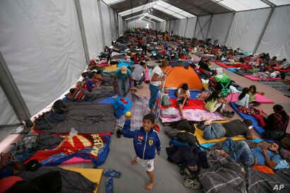 Central American migrants, part of a caravan hoping to reach the U.S. gets settled in a shelter at the Jesus Martinez stadium, in Mexico City, Nov. 5, 2018.