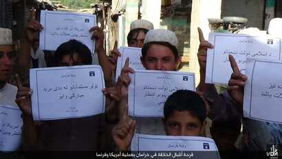 """IS social media distributed photos in several languages of children holding placards in Islamic State territories offering """"congratulations"""" on the deaths of Americans, apparently in reference to the Orlando mass shooting on June 12, 2016."""
