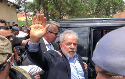 Former Brazilian President Luiz Inacio Lula da Silva leaves for the cemetery to attend the funeral of his 7-year-old grandson, in Sao Bernardo do Campo, Brazil, March 2, 2019.