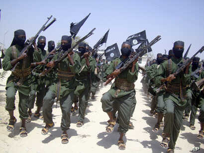 FILE - Al-Shabab fighters are seen marching with their weapons during exercises on the outskirts of Mogadishu, Somalia, Feb. 17, 2011. The Pentagon says a U.S. airstrike against al-Shabab in Somalia last Saturday killed more than 150 militants.
