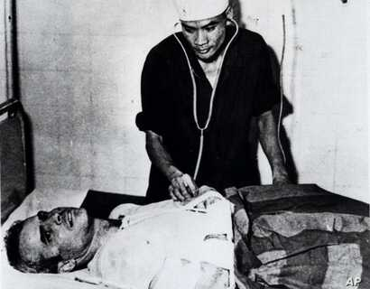 FILE - John McCain is administered to in a Hanoi, Vietnam hospital as a prisoner of war in the fall of 1967.