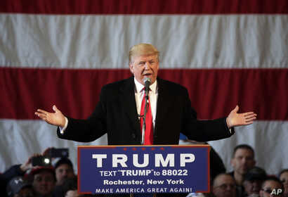 Republican presidential candidate Donald Trump speaks during a rally at JetSmart Aviation Services on Sunday, April 10, 2016, in Rochester, New York.