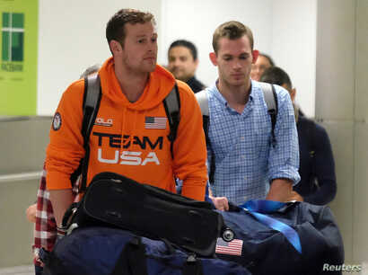U.S. Swimmers Jack Conger and Gunnar Bentz arrive on an overnight flight from Brazil to Miami in Miami, August 19, 2016.