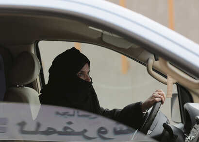 FILE - A woman drives a car on a highway in Riyadh, Saudi Arabia, as part of a campaign to defy Saudi Arabia's ban on women driving, March 29, 2014. Women's rights activists are among those being detained in Saudi Arabia.