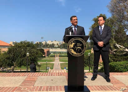 California Attorney General Xavier Becerra speaks at UCLA about his efforts to fight the Trump administration's proposal to weaken car efficiency fuel standards in Los Angeles, Aug. 2, 2018. Deputy Attorney General David Zaft is on the right.