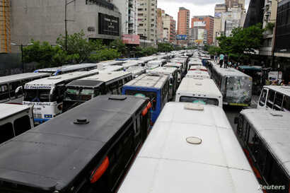 Buses blocking an avenue are seen during a public transport protest in Caracas, Venezuela, Sept. 21, 2016.