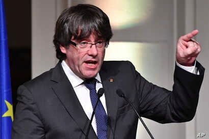 Ousted Catalan leader Carles Puigdemont addresses Catalan mayors who traveled to Brussels in support of the ousted Catalan government in Brussels, Belgium, Nov. 7, 2017.