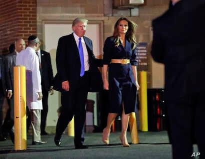 President Donald Trump and first lady Melania Trump walk to their vehicle after visiting the Washington hospital where House Majority Leader Steve Scalise was taken after being shot in Alexandria, Va., June 14, 2017.