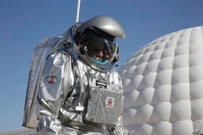 This Feb. 7, 2018, photo shows analog astronaut Kartik Kumar wearing an experimental space suit during a simulation of a future Mars mission in the Dhofar desert of southern Oman.