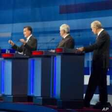 Massachusetts Gov. Mitt Romney; former House Speaker Newt Gingrich; and Rep. Ron Paul, R-Texas take part in the South Carolina Republican presidential candidate debate in Myrtle Beach, S.C, January 16, 2012.
