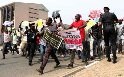 People protest at the secretariat of the Nigerian Bar Association following the suspension of Nigeria's Chief Justice Walter Onnoghen, in Abuja Nigeria, Jan. 28, 2019.