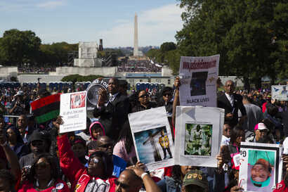 People cheer during a rally to mark the 20th anniversary of the Million Man March in Washington, Oct. 10, 2015.