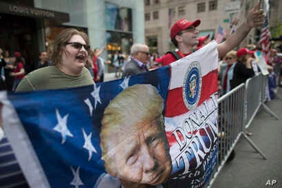 """Trump supporters hold a counter rally during """"100 Days of Failure"""" protest and march, Saturday, April 29, 2017, in New York.  Thousands of people across the U.S. are marching on President Donald Trump's hundredth day in office to demand action on cli..."""