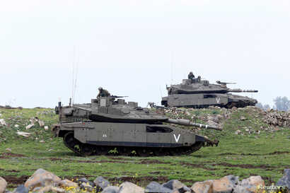 Israeli soldiers take part in an exercise in the Israeli-occupied Golan Heights, near the ceasefire line between Israel and Syria, March 20, 2017.