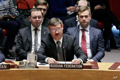 Acting Russia ambassador Petr Iliichev, center, delivers remarks to the U.N. Security Council in New York, Feb. 21, 2017.
