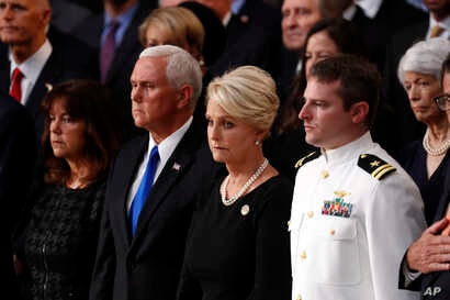 Cindy McCain stands with Vice President Mike Pence and Jack McCain, right, during a ceremony as the casket of Sen. John McCain lies in state at the Rotunda of the U.S. Capitol in Washington, Aug. 31, 2018.