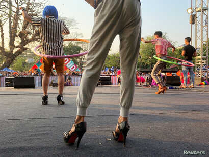 Performers hula hoop at a contest of the Drag Olympics at Yangon Pride festival in Yangon, Myanmar, January 27, 2019.