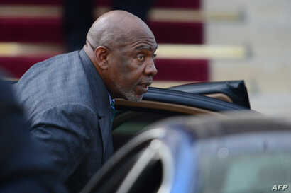 FILE - Mali's then-prime minister, Cheikh Modibo Diarra, arrives at the French foreign ministry prior to a meeting with French officials, Sept. 20, 2012, in Paris.