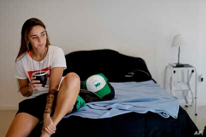 "FILE - Soccer player Macarena Sanchez drinks ""mate"" at her home in Buenos Aires, Argentina, Jan. 31, 2019."