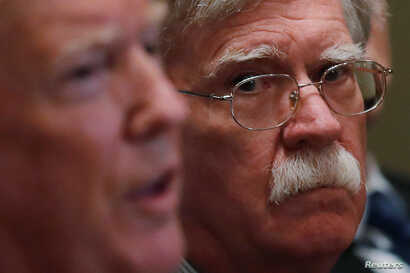 White House national security adviser John Bolton participates in a briefing from senior military leaders for President Donald Trump in the Cabinet Room of the White House in Washington, April 9, 2018.