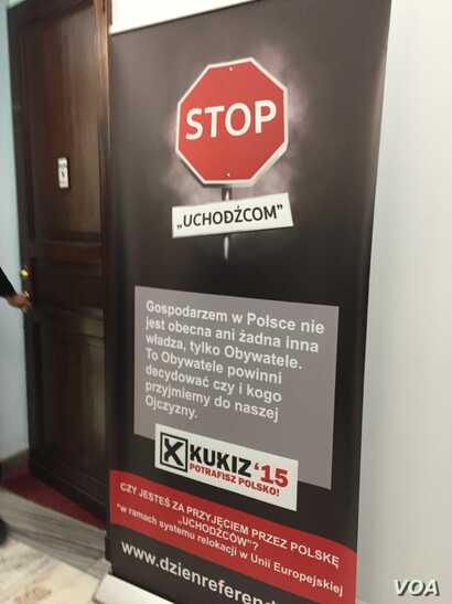 "A sign outside the Kukiz 15 movement's offices in the parliament building in Warsaw, Poland, reads ""stop refugees.""  (VOA/L. Ramirez)"