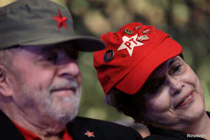 Former Brazilian President Luiz Inacio Lula da Silva, left, and Former Brazilian President Dilma Rousseff are seen wearing party caps during the opening ceremony of the national congress of the Workers' Party in Brasilia, Brazil, June 1, 2017.