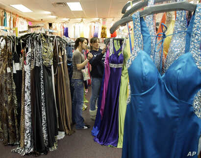 FILE - Girls shop for prom dresses at Angelique's in Saugus, Massachusetts, March 17, 2009.