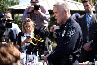 Police chief Brian Manley speaks during a news conference near the scene where a woman was injured in a package bomb explosion in Austin, Texas, March 12, 2018.