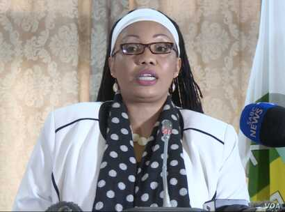 """Priscilla Chigumba, the chairperson of the Zimbabwe Electoral Commission says issues the opposition is raising """"were now water under the bridge."""" In this photo (07/13/2018) she talks to reporters in Harare."""