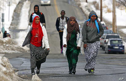 Students walk home from school in Lewiston, Maine, Jan. 26, 2016. Since February 2000, more than 5,000 Africans have come to Lewiston, a city of 36,500.